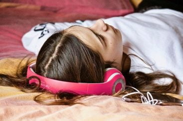Girl Listening to Subliminal Messages