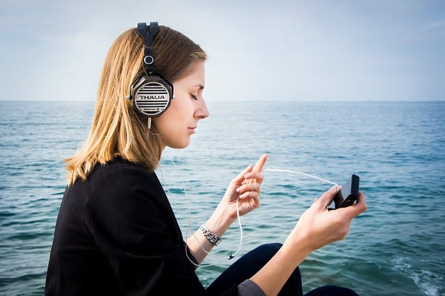 Girl listening to subliminal messages with headphones