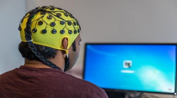 Man with eeg devide on his head