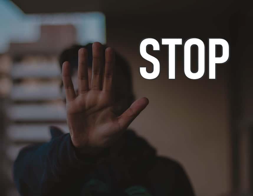 Hand signaling stop.