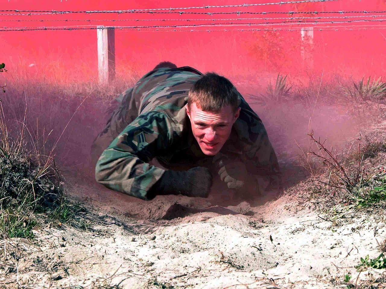 Man Crawling Through Obstacle Course