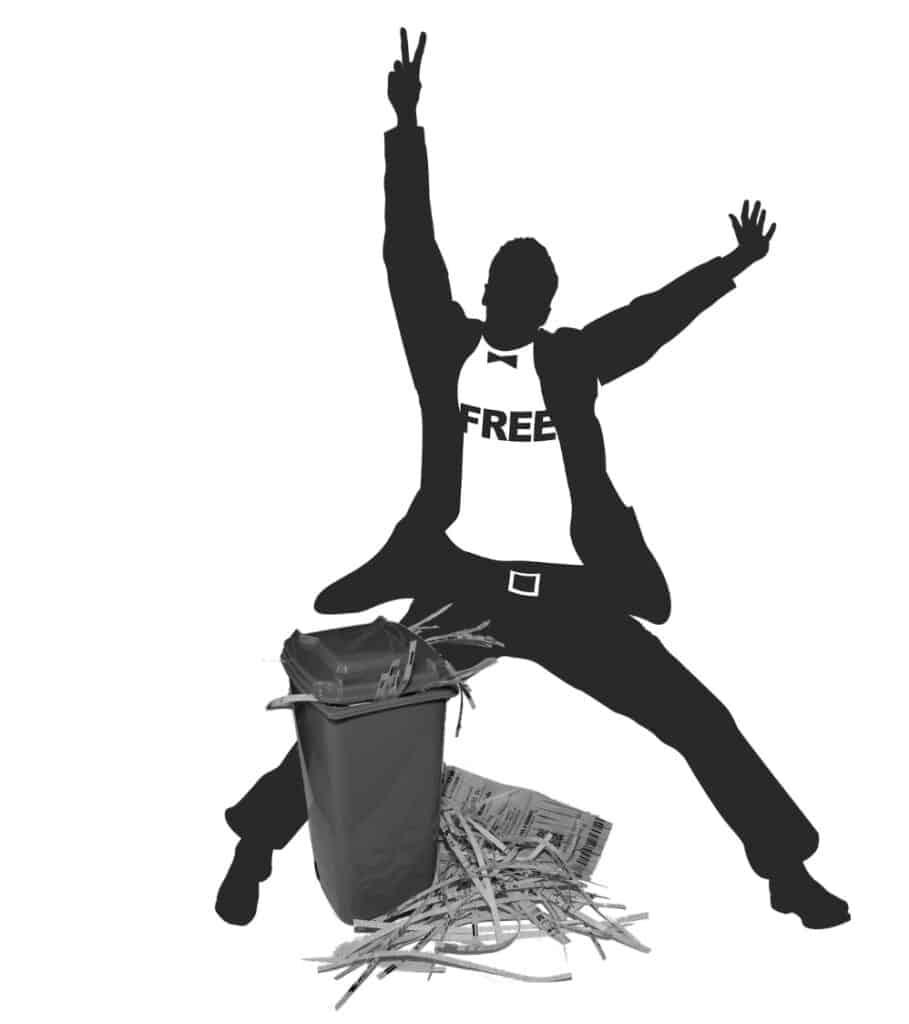 Man celebrating over shredded paper